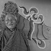 The phalluses painted on the Bhutanese homes are meant to bring fertility and protect the family from evil, Villager of Punakha Valley, Bhutan, Asia