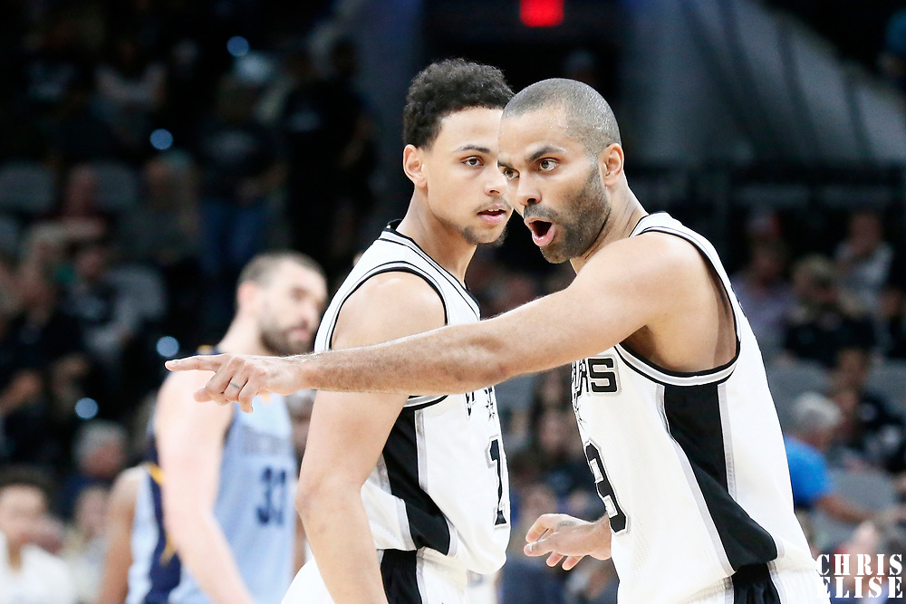 04 April 2017: San Antonio Spurs guard Tony Parker (9) talks to San Antonio Spurs guard Bryn Forbes (11) during the San Antonio Spurs 95-89 OT victory over the Memphis Grizzlies, at the AT&T Center, San Antonio, Texas, USA.