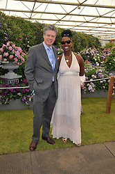 BARONESS BENJAMIN and her husband KEITH TAYLOR at the 2011 RHS Chelsea Flower Show VIP & Press Day at the Royal Hospital Chelsea, London, on 23rd May 2011.