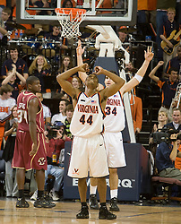 Virginia guard Sean Singletary (44) and Virginia forward/center Ryan Pettinella (34) celebrate at the end of the game against BC.  The Virginia Cavaliers men's basketball team defeated the Boston College Golden Eagles 84-66 at the John Paul Jones Arena in Charlottesville, VA on January 19, 2008.