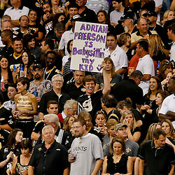 Sep 21, 2014; New Orleans, LA, USA; A fan holds up a sign in reference to Minnesota Vikings running back Adrian Peterson (not pictured) during the first quarter of a game  against the New Orleans Saints at Mercedes-Benz Superdome. Mandatory Credit: Derick E. Hingle-USA TODAY Sports