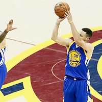 10 June 2016: Golden State Warriors guard Stephen Curry (30) takes a jump shot over Cleveland Cavaliers guard Iman Shumpert (4) on a screen set by Golden State Warriors forward Anderson Varejao (18) during the Golden State Warriors 108-97 victory over the Cleveland Cavaliers, during Game Four of the 2016 NBA Finals at the Quicken Loans Arena, Cleveland, Ohio, USA.