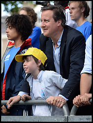 Image ©Licensed to i-Images Picture Agency. 05/07/2014. Yorkshire, United Kingdom.The Prime Minster and his son Elwyn  watch the Tour de France at finish line in Harrogate on stage one of the race . Picture by Andrew Parsons / i-images