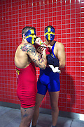 Swedish fans of Olympic wrestling pose for a photograph with another fans baby at the Excel Centre in East London