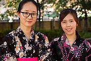 Young women in yukata (summer kimono) watching the Tenjin Festival (Tenjin Matsuri) in Osaka.