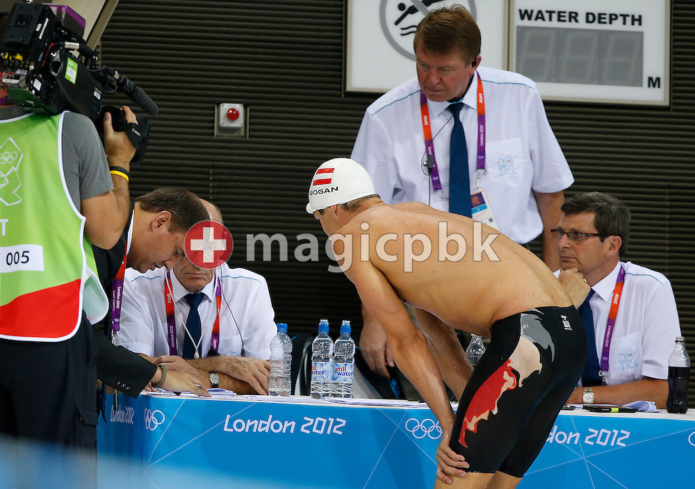 Markus Rogan of Austria talks to the referees after being disqualified in the men's 200m Individual Medley (IM) Semifinal during the Swimming competition held at the Aquatics Center during the London 2012 Olympic Games in London, Great Britain, Wednesday, August 1, 2012. (Photo by Patrick B. Kraemer / MAGICPBK)