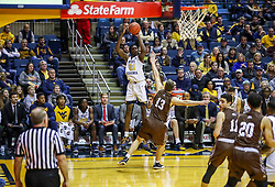 Dec 30, 2018; Morgantown, WV, USA; West Virginia Mountaineers forward Wesley Harris (21) shoots a three pointer during the second half against the Lehigh Mountain Hawks at WVU Coliseum. Mandatory Credit: Ben Queen-USA TODAY Sports