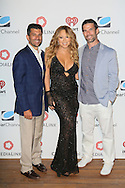 CAP D'ANTIBES, FRANCE - JUNE 17: – Tim Spengler, President of Content Marketing and Revenue, Clear Channel?  Mariah Carey and Greg Glenday – President of Connections, Clear Channel attend Clear Channel Media And Entertainment And MediaLink Dinner at Hotel du Cap-Eden-Roc on June 17, 2014 in Cap d'Antibes, France.  (Photo by Tony Barson/Getty Images for Clear Channel)