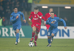 SOFIA, BULGARIA - Wednesday, March 3, 2004: Liverpool's Steven Gerrard and Levski Sofia's Sasha Simonovic during the UEFA Cup 4th Round 2nd Leg match at the Vasil Levski Stadium, Sofia, Bulgaria. Wednesday, March 3rd, 2004...Picture by David Rawcliffe/Propaganda..Any problems please call David Rawcliffe on 07973 14 2020 or email david@propaganda-photo.com.