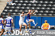 Pat Ah Van goes up with Craig Hall during the First Utility Super League match between Widnes Vikings and Wakefield Wildcats at the Select Security Stadium, Halton, United Kingdom on 21 August 2016. Photo by Craig Galloway.