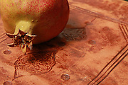 Atmospheric image of Judaism symbols of Rosh Hashana, The Jewish New Year and Succoth. A Prayer Book, and Pomegranate