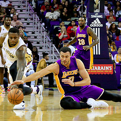 Nov 12, 2016; New Orleans, LA, USA;  Los Angeles Lakers forward Larry Nance Jr. (7) and New Orleans Pelicans forward Terrence Jones (9) scramble for a loose ball during the first half of a game at the Smoothie King Center. Mandatory Credit: Derick E. Hingle-USA TODAY Sports