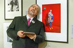 Pictured: Phill Jupitus sketches a picture of the artist Grayson Perry from a portrait by Richard Ansett, at the Scottish National Portrait Gallery, The celebrated, award-winning stand-up comic, performance poet and broadcast personality Phill Jupitus will return to the National Galleries of Scotland this summer with Sketch Comic. Part of the Edinburgh Fringe Festival, the show highlights his deep love of art and follows on from the success of two hugely popular runs in 2014 and 2015.<br /> <br /> <br /> <br /> Michael Schfield | EEm 17/7/2017