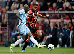 AFC Bournemouth's Joshua King (right) and Stoke City's Bruno Martins Indi (left) battle for the ball
