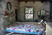A colorful quilt covers a bed in the stone Pratt Cabin (built 1932, donated 1957), on the McKittrick Canyon Trail. Hike some of the most scenic trails in Texas in Guadalupe Mountains National Park, in the Chihuahuan Desert, near El Paso, USA. Hiking the ecologically-diverse McKittrick Canyon in Guadalupe Mountains NP is best when fall foliage turns color.