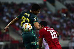 September 20, 2018 - Piraeus, Attiki, Greece - Ahmed Hassan (no 18) of Olympiacos and Aissa Mandi (no 23) of Real Betis, vies for the ball. (Credit Image: © Dimitrios Karvountzis/Pacific Press via ZUMA Wire)