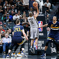 02 April 2017: San Antonio Spurs guard Tony Parker (9) goes for the jump shot past Utah Jazz center Rudy Gobert (27) during the San Antonio Spurs 109-103 victory over the Utah Jazz, at the AT&T Center, San Antonio, Texas, USA.
