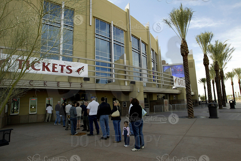 13 February 2004: Phoenix Coyotes new home arena named the Glendale Arena in AZ.  A general exterior view shortly after the grand opening in the middle of the NHL season. Fans in line outside to purchase tickets.  Venue holds concerts, sporting and special events.  Mandatory Credit: Photo by Shelly Castellano