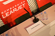 Ready for the arrival of Formula 1 driver Lewis Hamilton who is about to attend a press conference hosted by the aircraft manufacturer Bombardier, his name is seen on a press conference table. He uses Bombardier's Learjet 45 to attend races and events around the world. Fulfilling his commitments to the many sponsors of his McLaren team and those of his personal life, Hamilton travels to events between his professional driving at Grand Prix around the world. He uses the Learjet as a means of fast flight after races to spend more time with his family and to prepare for the next track competition.