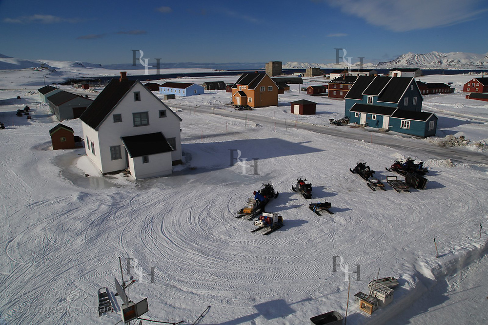 International science village of Ny-Alesund sits amid April snows on Spitsbergen island in Kongsfjorden; Svalbard, Norway.