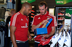 CARDIFF, WALES - Thursday, June 2, 2016: Wales' Gareth Bale and captain Ashley Williams buy Adidas trainers during a visit to a JD Sports store in Llantrisant. (Pic by Ian Cook/Propaganda)