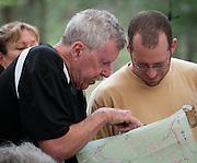 Veteran Barkley runner Stu Gleman, left, gives advice to first time runner Joel Gat at the Barkley Marathons in Frozen Head State Park in TN.