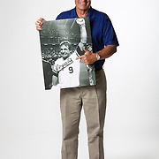 Former Major League Baseball player Dane Iorg poses with of photo of himself when he was a player for the Kansas City Royals and is leaving the field after winning the World Series. Portraits were taken in the studio in Orem, Utah,  Thursday May 31, 2012. (Photo by August Miller).