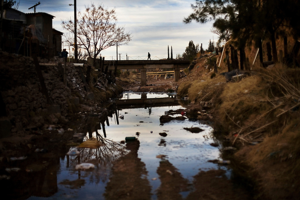 Rain runoff and garbage fester in a ditch in a poor neighborhood of Nogales.