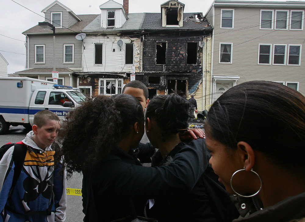 (040708 South Boston, MA)   School friends of Acia's, at left, Daisy Miranda, 14, visit the scene as investigators  continue to work the site of a South Boston fire on W. 6th street that claimed the lives of two young girls, Acia Johnson, 13, and her 3 year old sister Sophia.