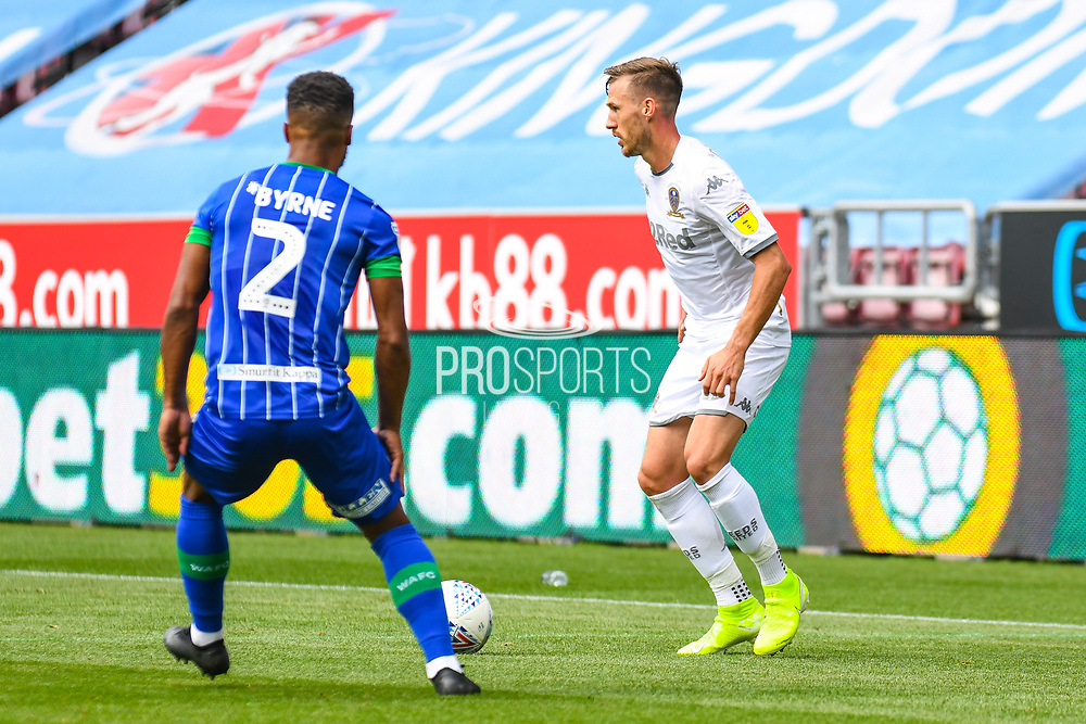 Leeds United defender Barry Douglas (3) in action during the EFL Sky Bet Championship match between Wigan Athletic and Leeds United at the DW Stadium, Wigan, England on 17 August 2019.