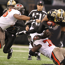 Dec 27, 2009; New Orleans, LA, USA;  New Orleans Saints safety Darren Sharper (42) knocked into the air by Tampa Bay Buccaneers offensive tackle Donald Penn (70) after intercepting a pass during the first quarter at the Louisiana Superdome. Mandatory Credit: Derick E. Hingle-US PRESSWIRE..