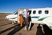 31 OCTOBER 2010 - WINDOW ROCK, AZ:    Terry Goddard climbs out of the plane in Window Rock.  Goddard, and the other Democrats on the statewide ticket, campaigned in Window Rock and Kingman on Halloween. Goddard ended the day with a press conference in front of the Executive Office Tower at the State Capitol in Phoenix.  Goddard lost the election to sitting Governor Jan Brewer, a conservative Republican.     PHOTO BY JACK KURTZ