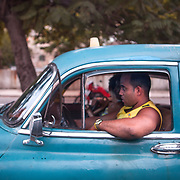 Old classic cars some carry tourists others are the everyday transportation for Cubans. Photography by Jose More