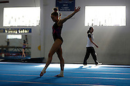 Rachel Gowey, 18, of Urbandale, Iowa, practices her floor routine as assistant coach Liwen Zhuang looks on Friday, May 6, 2016, at Chow's Gymnastics and Dance in West Des Moines.