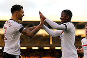 Fulham defender Ryan Fredericks (2) and Fulham striker Floyd Ayite (11) celebrate the own goal from Reading defender Chris Gunter (2) during the EFL Sky Bet Championship match between Fulham and Reading at Craven Cottage, London, England on 3 December 2016. Photo by Andy Walter.