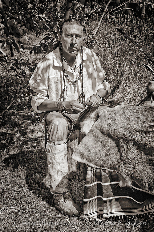 A trader working on his goods at a Mountain Man Rendezvous in Red Lodge, Montana.