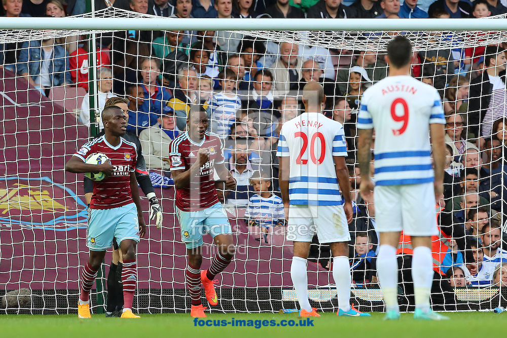Diafra Sakho (centre) celebrates after scoring the second goal of the Barclays Premier League match against Queens Park Rangers at the Boleyn Ground, London<br /> Picture by Richard Calver/Focus Images Ltd +447792 981244<br /> 05/10/2014