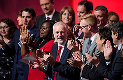 © Licensed to London News Pictures . 27/09/2017. Brighton, UK. Labour Party leader JEREMY CORBYN laughing after singer red flag at the end of his leaders speech on day 4 of the 2017 the Labour Party Conference, held at The Brighton Centre in East Sussex. Photo credit: Ben Cawthra/LNP