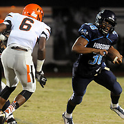 Hoggard's Keevin Thompson rushes against New Hanover Friday October 3, 2014 in Wilmington, N.C. (Jason A. Frizzelle)