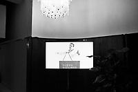 Palermo, Italy, 25 October 2012: A video of Candidate for Governor of Sicily Gianfranco Micciché explaining his political program which consists in streamlining the bureaucratic procedures of the Sicilian region for businesses, is seen on display at the entrance of his electoral committee in Palermo, Italy, on October 25 2012. <br /> <br /> The direct elections in Sicily for the President of the Region and its representatives will take place on Sunday 28 October 2012, 6 months ahead of the end of the terms of office of the current legislature. The anticipated election of October 28 take place after Raffaele Lombardo, former governor of Sicily since 2008, resigned on July 31st. Raffaele Lombardo is under investigation since 2010 for Mafia ties. His son Toti Lombardo is currently running for a seat in the Sicilian Regional Assembly in the coalition of Gianfranco Micciché, a candidate for the Presidency of the Region. 32 candidates belonging to 8 of the 20 parties running for the Sicilian elections are either under investigation or condemned. ### Palermo, Italia, 25 ottobre 2012:  un video proietta le immagini del cadidato alla Presidenza della Regione Sicilia Gianfranco Micciché (58 anni) che espone il suo programma che consiste nella sburocratizzazione della Regione Sicilia, all'entrata del suo comitato elettorale a Palermo il 25 ottobre 2012. <br /> Le elezioni in Sicilia per la votazione diretta del presidente della regionee dei deputati all'Assemblea regionale (ARS)si terranno domenica 28 ottobre, in anticipo sulla scadenza naturale dell'attuale legislatura, prevista ad aprile dell'anno prossimo. In Sicilia si vota in anticipo dopo le dimissionidel 31 luglio scorso di Raffaele Lombardo, eletto presidente della regione nell'aprile del 2008 e indagato dal 2010 per concorso esterno in associazione mafiosa. 32 candidati appartenenti a 8 delle 20 liste candidate alle elezioni siciliani sono indagati o condannati.