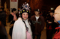 Stock photo of a woman dressed traditionally for the Chinese New Year celebrations in downtown Houston Texas