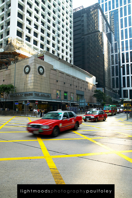 Taxis crossing intersection, Hong Kong, China,