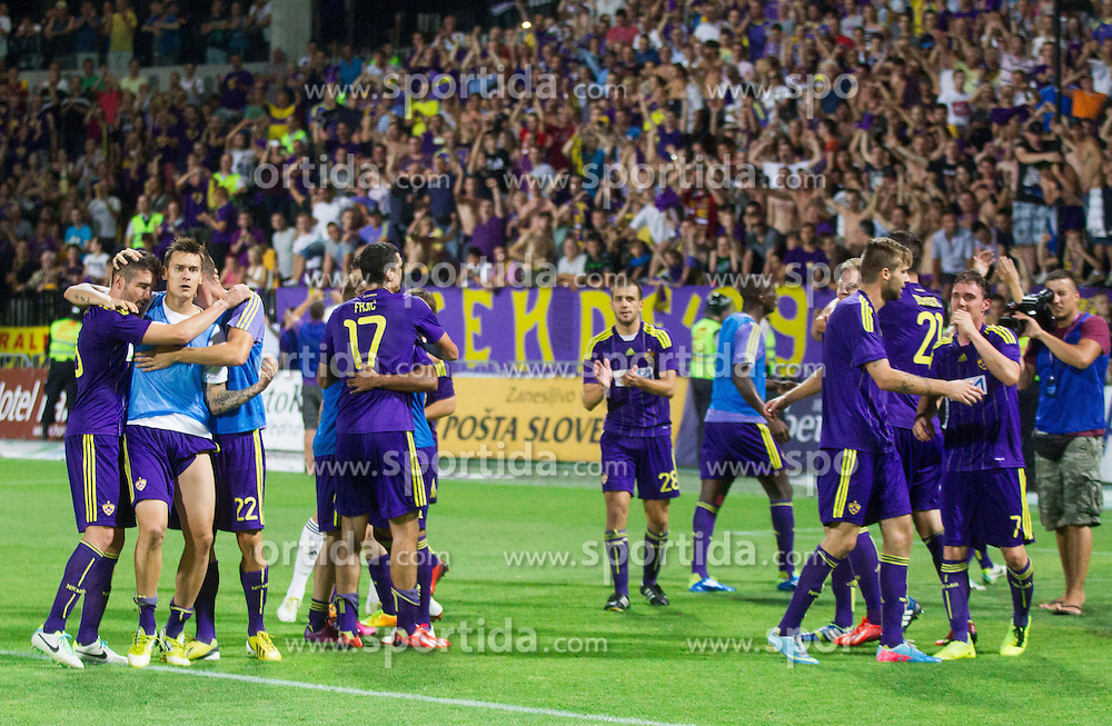 Players of Maribor celebrate after the football match between NK Maribor and APOEL FC, (Cyprus) in Third qualifying round, Second leg of UEFA Champions League 2014, on August 6, 2013 in Stadium Ljudski vrt, Maribor, Slovenia. (Photo by Vid Ponikvar / Sportida.com)