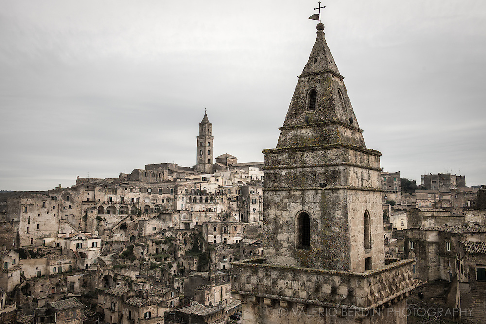 """A courtyard in the area of """"the sassi"""". A courtyard in the area of """"the sassi"""". Panorama of Matera. Already UNESCO world heritage site, recently named European Capital of Culture for 2019, Matera is a city in the Region of Basilicata in the south of Italy."""