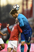 Arsenal defender Mathieu Debuchy (2) battles with Nottingham Forest forward Zach Clough (16) during the The FA Cup 3rd round match between Nottingham Forest and Arsenal at the City Ground, Nottingham, England on 7 January 2018. Photo by Jon Hobley.