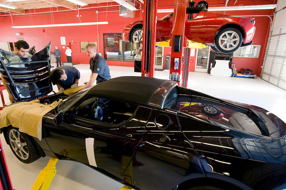 Geoff Cutler (right) is a mechanic at Tesla Motors he works at the garage behind the showroom at Tesla Motors Inc.  The California  based company builds electro luxury cars.The 2008 Tesla Roadster is an electric sports car that accelerates from 0 to 60 MPH in 3.9 sec..Alternative Energy in Silicon Valley and the San Francisco Bay Area..(Attention: car plate made unreadable by the photographer upon the request by Tesla Motors Inc)