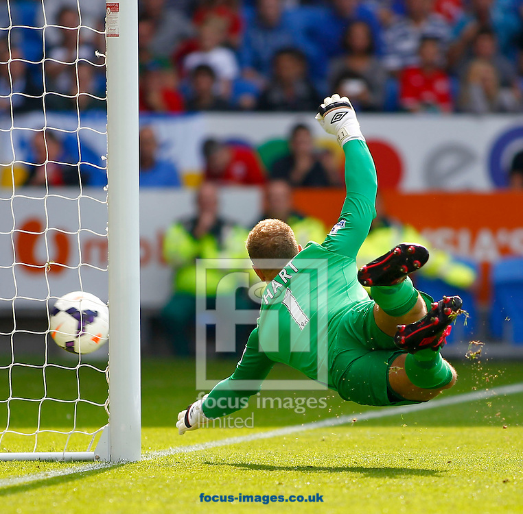 Picture by Mike  Griffiths/Focus Images Ltd +44 7766 223933<br /> 25/08/2013<br /> Joe Hart of Manchester City gets down to stop Fraizer Campbell's shot during the Barclays Premier League match at the Cardiff City Stadium, Cardiff.
