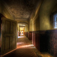An abandoned palace in East Germany with sunlight in a hallway
