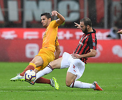 MILAN, Sept. 1, 2018  AC Milan's Gonzalo Higuain (R) vies with Roma's Ivan Marcano during a Serie A soccer match between AC Milan and AS Roma in Milan, Italy, Aug. 31, 2018. AC Milan won 2-1. (Credit Image: © Alberto Lingria/Xinhua via ZUMA Wire)