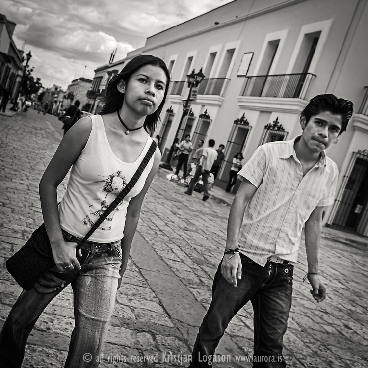 Young couple walking in the street of Oaxaca